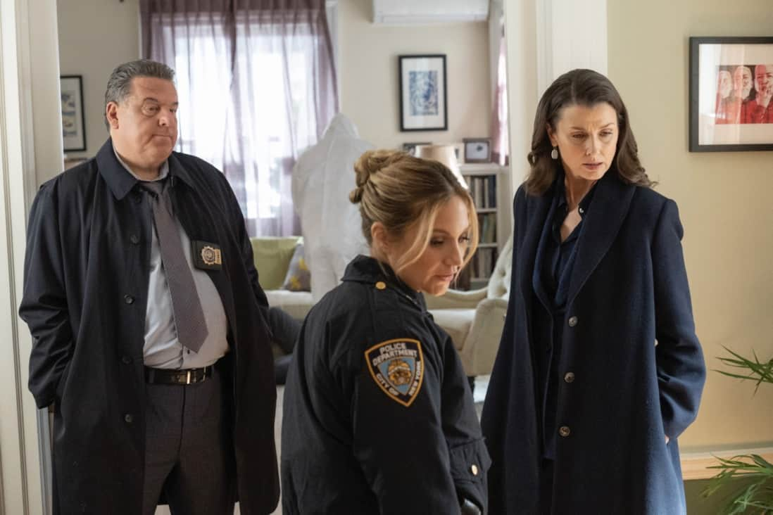"""BLUE BLOODS Season 11 Episode 15 """"The End"""" – Shockwaves ripple through the Reagan family when Danny discovers that their newest family member, Joe Hill (Will Hochman), is working undercover for the ATF to bring down a gunrunning organization, in the first part of the two-hour 11th season finale of BLUE BLOODS, at a special time, Friday, May 14 (9:00-10:00 PM ET/PT) on the CBS Television Network. Guest stars include Gloria Reuben as Special Agent Rachel Weber and Annabella Sciorra as M.E. Faith Marconi. Pictured:  Steven Schirripa as Anthony Abetamarco,  Vanessa Ray as Eddie Janko, Bridget Moynahan as Erin Reagan. Photo: John Paul Filo/CBS ©2021  CBS Broadcasting Inc. All Rights Reserved."""