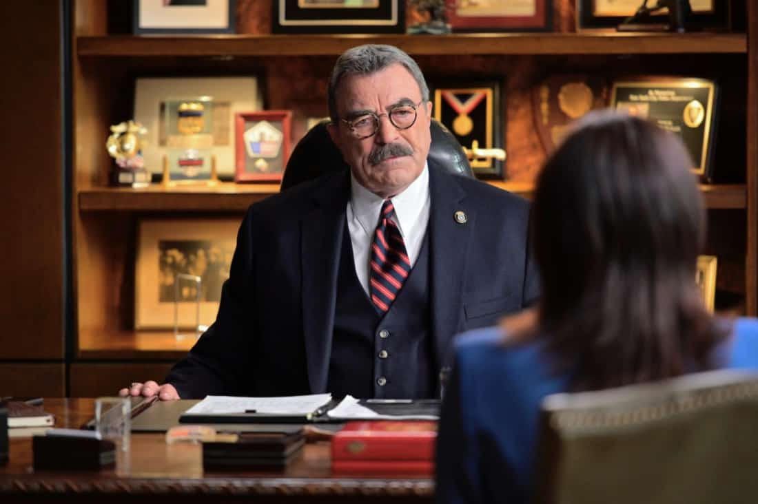 """BLUE BLOODS Season 11 Episode 16 """"Justifies The Means"""" – The Reagans band together to prevent Joe Hill from being killed in the line of duty like his father when they fear Joe's cover has been blown within the gunrunning outfit he's helping the ATF bring down, in the second part of the two-hour 11th season finale of BLUE BLOODS, Friday, May 14 (10:00-11:00 PM ET/PT) on the CBS Television Network. Gloria Reuben guest stars as Special Agent Rachel Weber. Pictured:  Tom Selleck as Frank Reagan,  Gloria Reuben guest stars as Special Agent Rachel Weber.   Photo: John Paul Filo/CBS ©2021  CBS Broadcasting Inc. All Rights Reserved."""