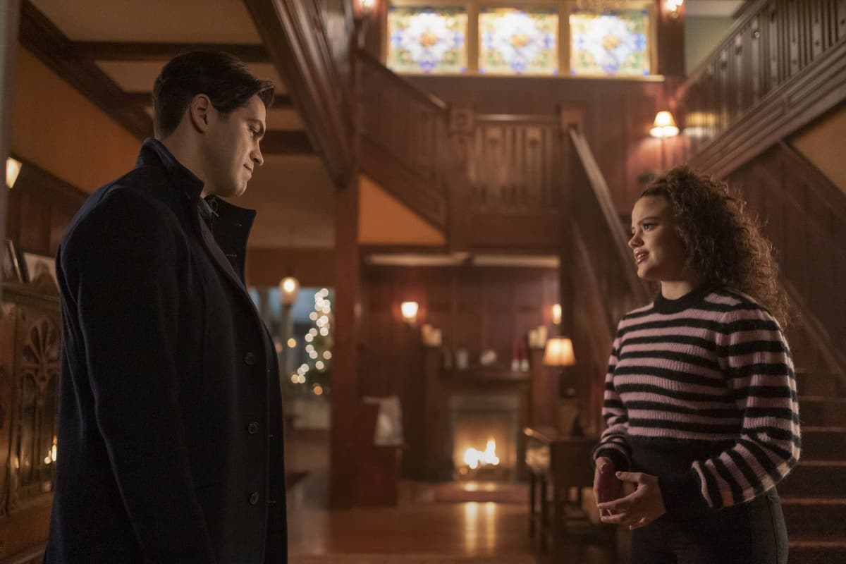 """CHARMED Season 3 Episode 12 -- """"Spectral Healing"""" -- Image Number: CMD312a_ 0129r -- Pictured (L-R): Jason Diaz as Antonio and Sarah Jeffery as Maggie Vera -- Photo: Colin Bentley/The CW -- © 2021 The CW Network, LLC. All Rights Reserved."""