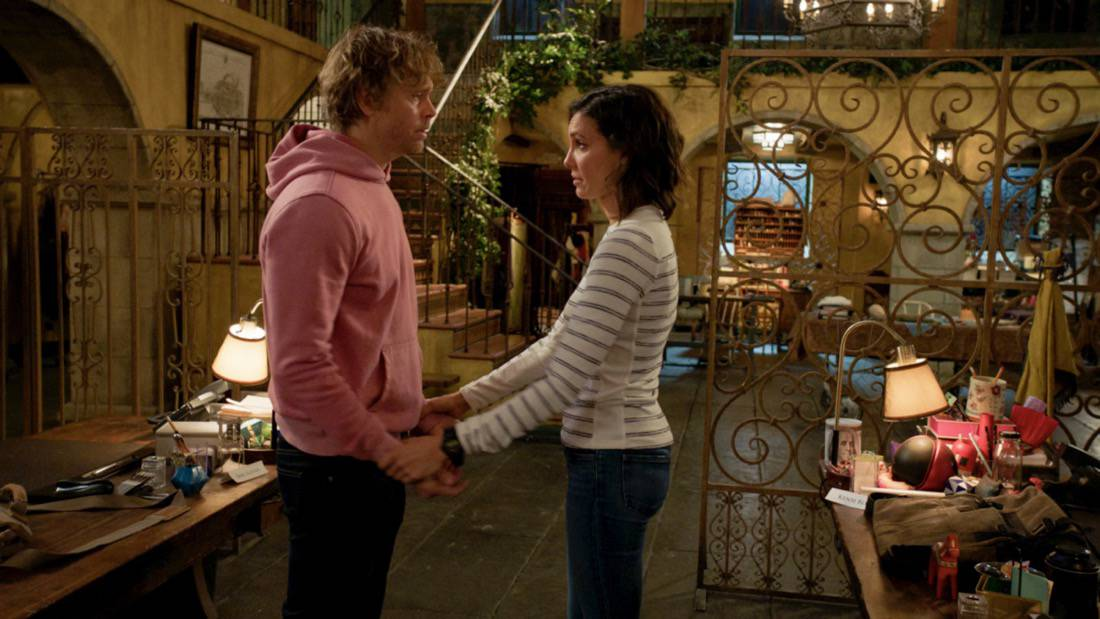 """NCIS LOS ANGELES Season 12 Episode 17 """"Through the Looking Glass"""" -- When a Naval Intelligence Officer is tortured and murdered, NCIS must work with Joelle (Elizabeth Bogush), who informs them that other CIA operatives are being killed in the same way. Also, Kensi receives a threatening postcard from David Kessler (Frank Military), the sociopath who is obsessed with her, on NCIS: LOS ANGELES, Sunday, May 16 (9:00-10:00 PM, ET/PT), on the CBS Television Network. Pictured:Daniela Ruah as Special Agent Kensi Blye,  Eric Christian Olsen as Investigator Marty Deeks.  Photo: Screen Grab/CBS ©2021 CBS Broadcasting, Inc. All Rights Reserved."""