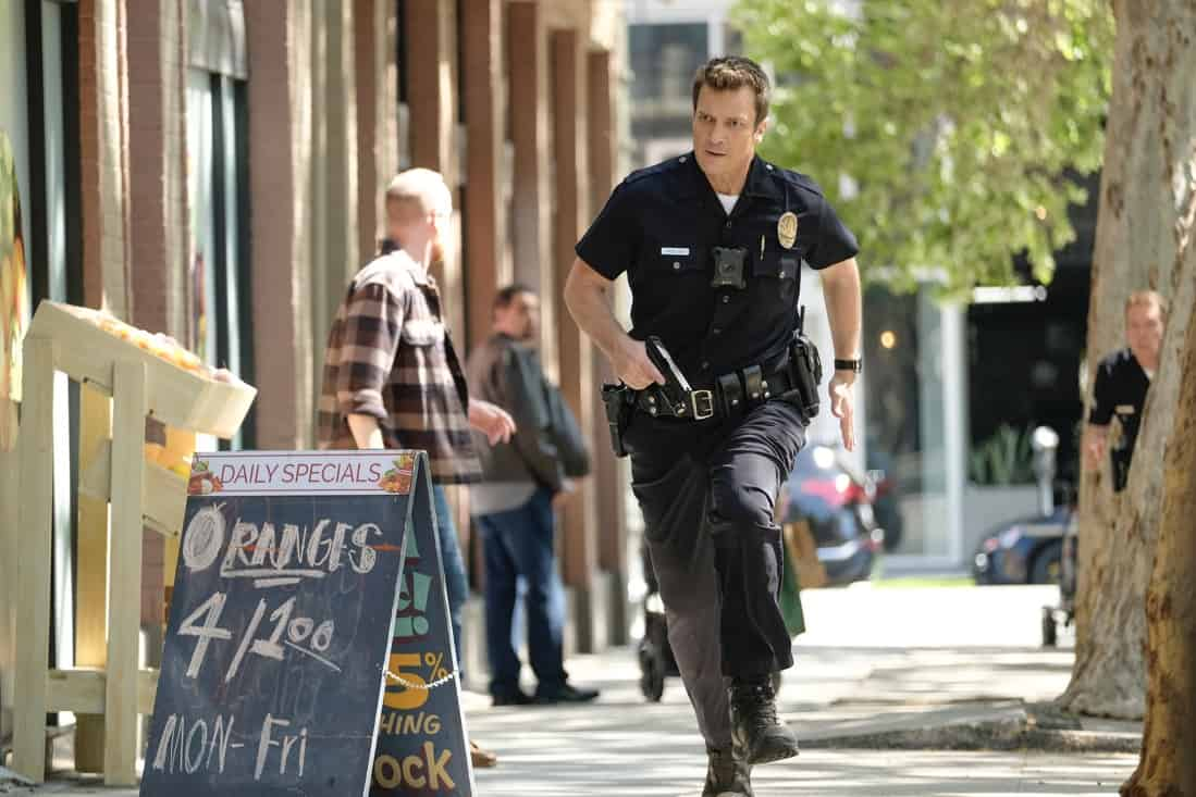 """THE ROOKIE Season 3 Episode 14 - """"Threshold"""" – Officer Nolan mildly injures himself while chasing down a shoplifter and the local DA wants to charge the suspect with assault despite Nolan's wishes. Meanwhile, Lucy goes undercover, Lopez' wedding venue is seized by the FBI and Nolan meets his new neighbor on the season finale of """"The Rookie,"""" SUNDAY, MAY 16 (10:00-11:00 p.m. EDT), on ABC. (ABC/Erica Parise) NATHAN FILLION"""