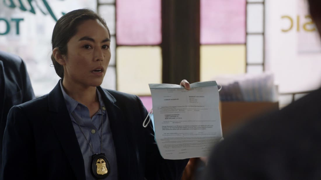 """NCIS NEW ORLEANS Season 7 Episode 15 """"Runs in the Family"""" – As Pride and Rita plan their wedding, the FBI arrests Connor (Drew Scheid) in connection to the bar's firebombing as a means of getting to his mother (Callie Thorne) and Rita may be the only person who can save them, on """"NCIS: NEW ORLEANS,"""" Sunday, May 16 (10:00-11:00 PM, ET/PT) on the CBS Television Network. Pictured: Cara Mitsuko as Agent Lee Photo: Screen Grab/CBS ©2021 CBS Broadcasting, Inc. All Rights Reserved."""