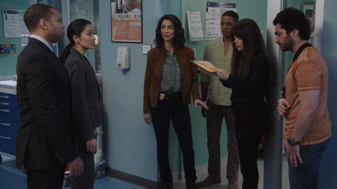 """NCIS NEW ORLEANS Season 7 Episode 15 """"Runs in the Family"""" – As Pride and Rita plan their wedding, the FBI arrests Connor (Drew Scheid) in connection to the bar's firebombing as a means of getting to his mother (Callie Thorne) and Rita may be the only person who can save them, on """"NCIS: NEW ORLEANS,"""" Sunday, May 16 (10:00-11:00 PM, ET/PT) on the CBS Television Network. Pictured L-R: Ezekiel Boston as Agent Everford, Jennifer Patino as Agent Griera, Necar Zadegan as Special Agent Hannah Khoury, Justin Davis as Morgan, Vanessa Ferlito as Special Agent Tammy Gregorio, and Haris Pervaiz as Faisal Photo: Screen Grab/CBS ©2021 CBS Broadcasting, Inc. All Rights Reserved."""
