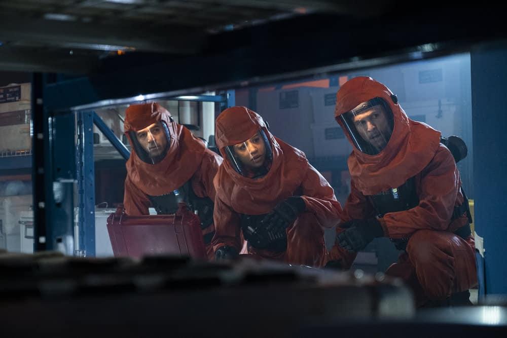 "DEBRIS Season 1 Episode 12 -- ""A Message From Ground Control"" Episode: 112 -- Pictured: (l-r) Tevis Toro as Vector Hazmat #2, Riann Steele as Finola Jones, Jonathan Tucker as Bryan Beneventi -- (Photo by: James Dittiger/NBC)"