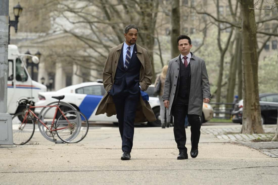 """BULL Season 5 Episode 16 """"A Friend in Need"""" – Izzy puts the brakes on her wedding to Bull when he jeopardizes Benny's election campaign by handling the defense in the corruption trial of the former District Attorney Benny hopes to replace, on the fifth season finale of BULL, Monday, May 17 (10:00-11:00 PM, ET/PT) on the CBS Television Network. Pictured L-R: Donovan Christie, Jr as ADA Ken Kiehl and Freddy Rodriguez as Benny Colón Photo: David M. Russell/CBS ©2021 CBS Broadcasting, Inc. All Rights Reserved"""