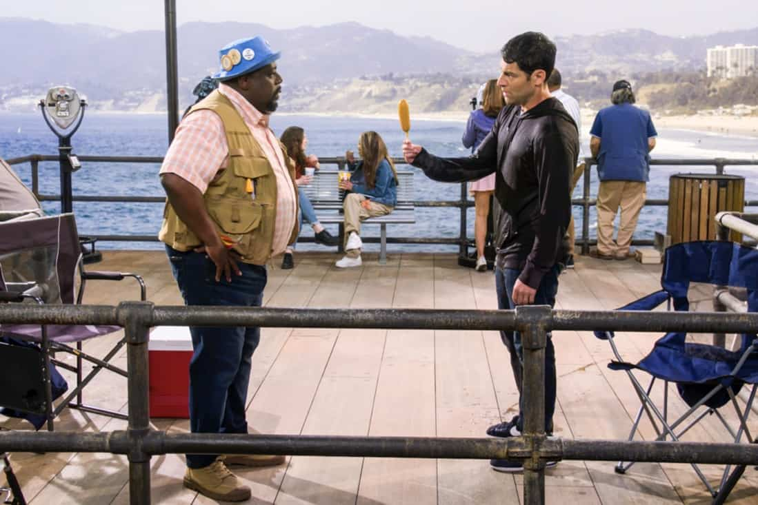 """THE NEIGHBORHOOD Season 3 Episode 18 """"Welcome to the Surprise"""" — Pictured: Cedric the Entertainer (Calvin Butler) and Max Greenfield (Dave Johnson). When Calvin receives an unconventional birthday gift involving his father, Dave suggests they spend the day celebrating in a way that honors the late Butler patriarch. Also, an unexpected development changes the Johnsons' lives forever, on the third season finale of THE NEIGHBORHOOD, Monday, May 17 (8:00-8:30 PM, ET/PT), on the CBS Television Network. Photo: Screen Grab/CBS ©2021 CBS Broadcasting, Inc. All Rights Reserved."""