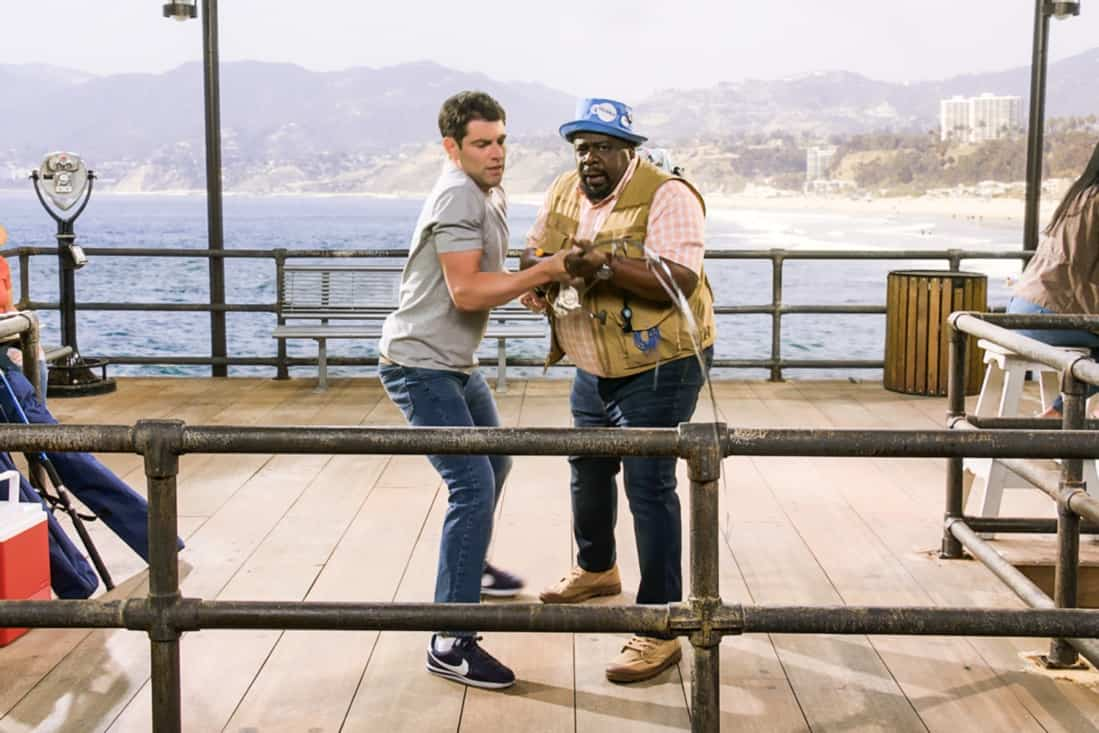 """THE NEIGHBORHOOD Season 3 Episode 18 """"Welcome to the Surprise"""" — Pictured: Max Greenfield (Dave Johnson) and Cedric the Entertainer (Calvin Butler). When Calvin receives an unconventional birthday gift involving his father, Dave suggests they spend the day celebrating in a way that honors the late Butler patriarch. Also, an unexpected development changes the Johnsons' lives forever, on the third season finale of THE NEIGHBORHOOD, Monday, May 17 (8:00-8:30 PM, ET/PT), on the CBS Television Network. Photo: Screen Grab/CBS ©2021 CBS Broadcasting, Inc. All Rights Reserved."""