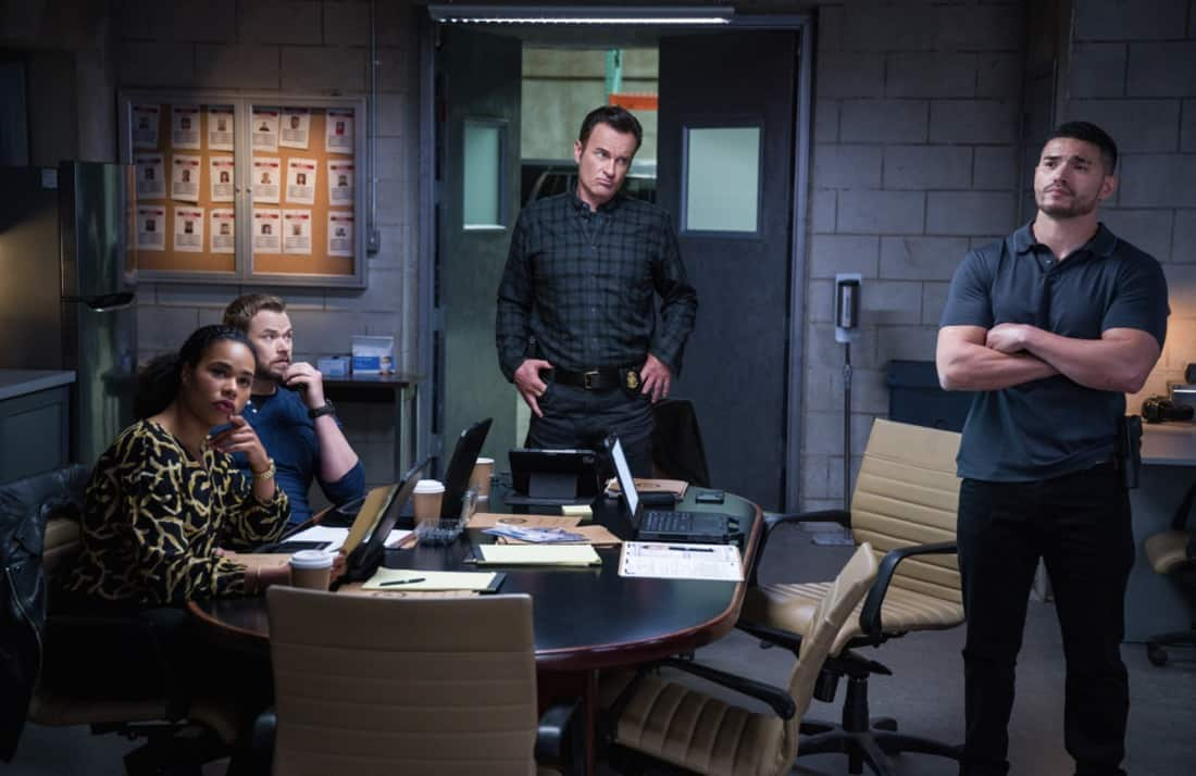"""FBI MOST WANTED Season 2 Episode 14 """"Hustler"""" - The team heads to D.C. to protect Ortiz's former informant after a hitman tries to kill her. Also, with help from Sarah, Jess' family prepares for Byron and Marie's last-minute wedding on Jess' farm, on FBI: MOST WANTED, Tuesday, May 18 (10:00-11:00 PM, ET/PT) on the CBS Television Network.   Pictured (L-R) Roxy Sternberg  as Special Agent Sheryll Barnes, Kellan Lutz as Special Agent Kenny Crosby, Julian McMahon as Supervisory Special Agent Jess LaCroix and Miguel Gomez as Special Agent Ivan Ortiz  Photo: Mark Schäfer/ ©2021 CBS Broadcasting Inc. All Rights Reserved."""
