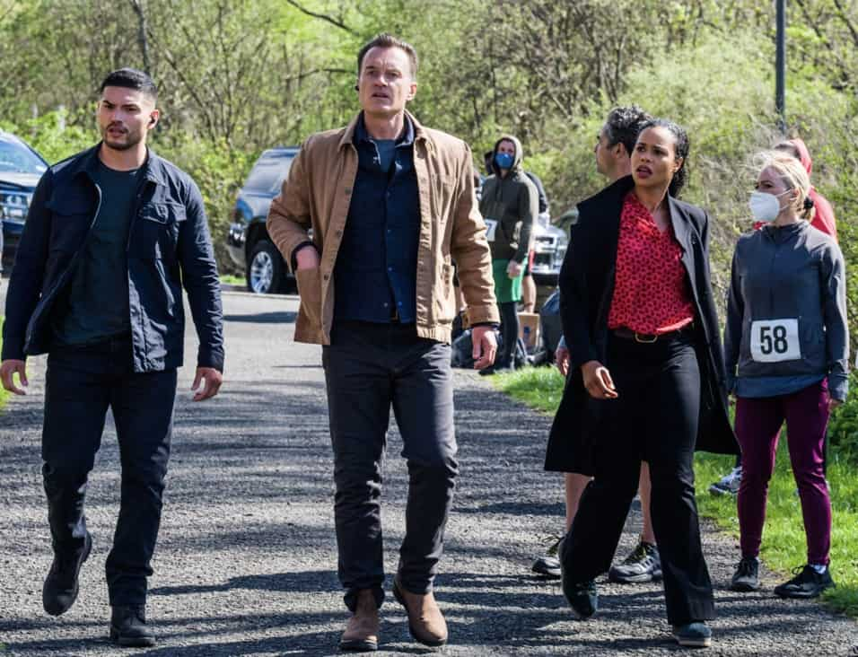 """FBI MOST WANTED Season 2 Episode 14 """"Hustler"""" - The team heads to D.C. to protect Ortiz's former informant after a hitman tries to kill her. Also, with help from Sarah, Jess' family prepares for Byron and Marie's last-minute wedding on Jess' farm, on FBI: MOST WANTED, Tuesday, May 18 (10:00-11:00 PM, ET/PT) on the CBS Television Network.   Pictured (L-R) Miguel Gomez as Special Agent Ivan Ortiz,  Julian McMahon as Supervisory Special Agent Jess LaCroix and Roxy Sternberg as Special Agent Sheryll Barnes Photo: Mark Schäfer/ ©2021 CBS Broadcasting Inc. All Rights Reserved."""
