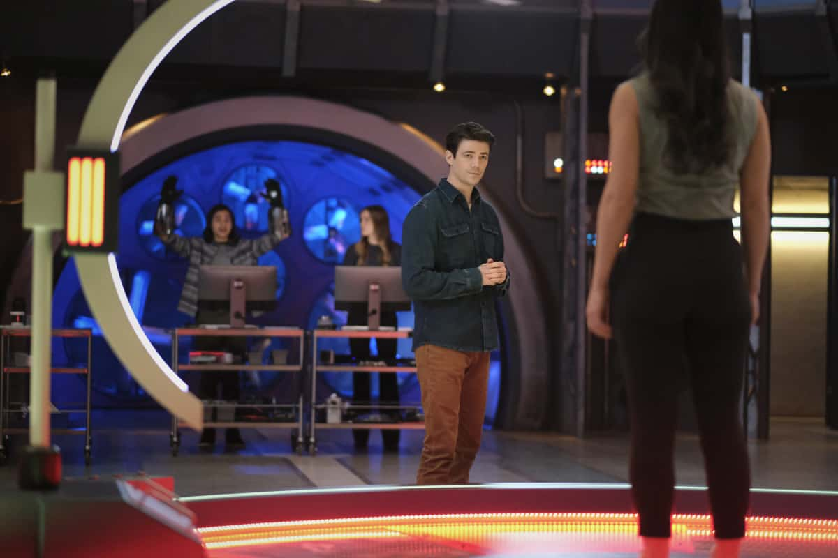 """THE FLASH Season 7 Episode 10 -- """"Family Matters, Part 1"""" -- Image Number: FLA710a_0103r.jpg -- Pictured (L-R): Carlos Valdes as Cisco Ramon, Danielle Panabaker as Caitlin Snow, Grant Gustin as Barry Allen and Sara Garcia as Alexa  -- Photo: Bettina Strauss/The CW -- © 2021 The CW Network, LLC. All Rights Reserved.Photo Credit: Bettina Strauss"""
