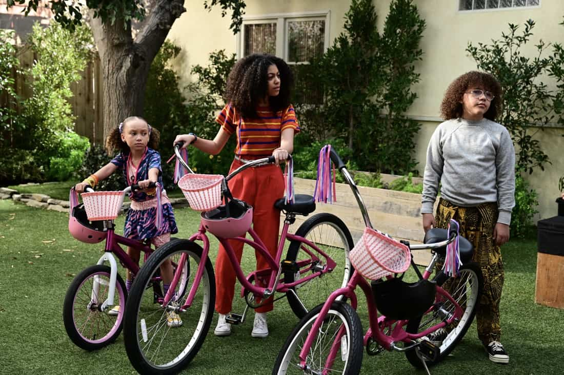 """MIXED-ISH Season 2 Episode 13- """"Forever Young"""" – In 2021, Adult Rainbow, Johan and Santamonica recall very different accounts of what happened the summer that they all got their new bicycles. In the '80s, an overprotective Alicia's worst fear comes true when one of the kids goes off on their own with their bike and gets lost. Meanwhile, Harrison catches Denise spending extra time in the office to get overtime and puts her to work on the season finale of """"mixed-ish,"""" TUESDAY, MAY 18 (9:30-10:00 p.m. EDT), on ABC. (ABC/Temma Hankin) MYKAL-MICHELLE HARRIS, ARICA HIMMEL, ETHAN WILLIAM CHILDRESS"""