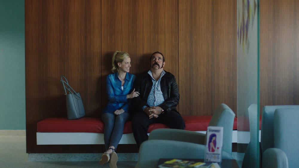 """QUEEN OF THE SOUTH Season 5 Episode 7 -- """"The Fox in the Hen House"""" Episode 507 -- Pictured in this screengrab: (l-r) Molly Burnett as Kelly Anne Van Awken, Hemky Madera as Pote -- (Photo by: USA Network)"""