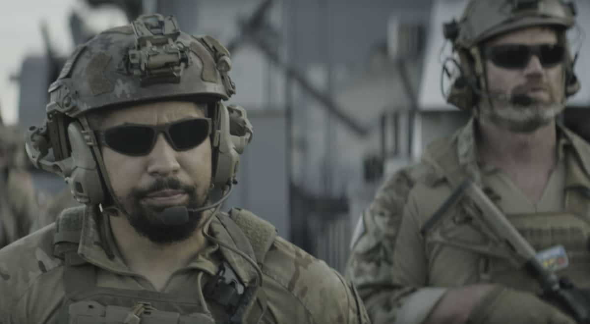"""SEAL TEAM Season 4 Episode 15 """"Nightmare of My Choice"""" – Bravo joins forces with Alpha team to protect a crucial Nigerian pipeline that is under attack by Boko Haram. But when a team member is injured and Jason and Clay fight to save his life, Bravo discovers that an even more dangerous enemy is attacking them, on SEAL TEAM, Wednesday, May 19 (9:00-10:00 PM, ET/PT) on the CBS Television Network. Pictured L to R: Neil Brown Jr. as Ray Perry and \sf]. Photo: CBS ©2021 CBS Broadcasting, Inc. All Rights Reserved."""