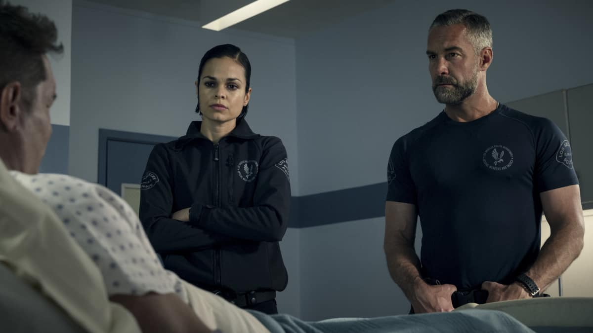 """SWAT Season 4 Episode 17 """"Whistleblower"""" – The team races to rescue victims of a sex trafficking ring that's preying on disenfranchised women. Also, Hondo finds himself at odds with Leroy and Darryl over the future of their business, and Street confronts Chris about meeting with his hospitalized mom, on S.W.A.T., Wednesday, May 19 (10:00-11:00 PM, ET/PT) on the CBS Television Network. Pictured (L-R): Lina Esco as Christina """"Chris"""" Alonso and Jay Harrington as David """"Deacon"""" Kay. Photo: Screengrab/CBS ©2021 CBS Broadcasting, Inc. All Rights Reserved"""