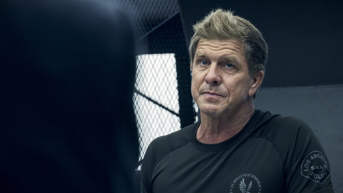 """SWAT Season 4 Episode 17 """"Whistleblower"""" – The team races to rescue victims of a sex trafficking ring that's preying on disenfranchised women. Also, Hondo finds himself at odds with Leroy and Darryl over the future of their business, and Street confronts Chris about meeting with his hospitalized mom, on S.W.A.T., Wednesday, May 19 (10:00-11:00 PM, ET/PT) on the CBS Television Network. Pictured (L-R): Kenneth """"Kenny"""" Johnson as Dominique Luca. Photo: Screengrab/CBS ©2021 CBS Broadcasting, Inc. All Rights Reserved"""