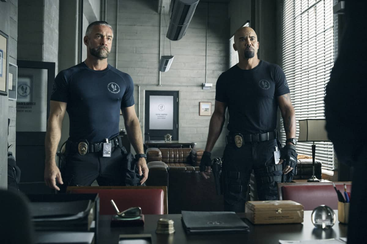 """SWAT Season 4 Episode 17 """"Whistleblower"""" – The team races to rescue victims of a sex trafficking ring that's preying on disenfranchised women. Also, Hondo finds himself at odds with Leroy and Darryl over the future of their business, and Street confronts Chris about meeting with his hospitalized mom, on S.W.A.T., Wednesday, May 19 (10:00-11:00 PM, ET/PT) on the CBS Television Network. Pictured (L-R): Jay Harrington as David """"Deacon"""" Kay and Shemar Moore as Daniel """"Hondo"""" Harrelson.   Photo: Screengrab/CBS ©2021 CBS Broadcasting, Inc. All Rights Reserved"""