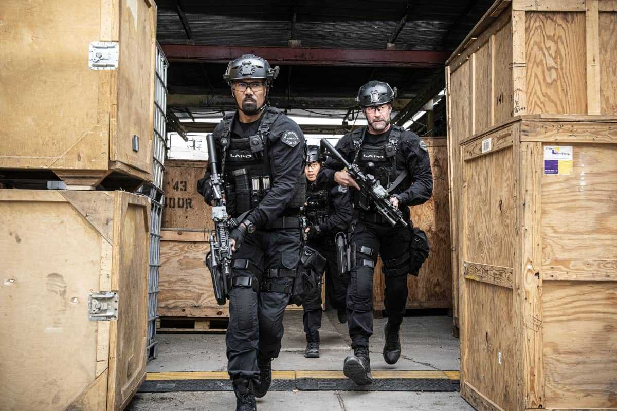 """SWAT Season 4 Episode 17 """"Whistleblower"""" – The team races to rescue victims of a sex trafficking ring that's preying on disenfranchised women. Also, Hondo finds himself at odds with Leroy and Darryl over the future of their business, and Street confronts Chris about meeting with his hospitalized mom, on S.W.A.T., Wednesday, May 19 (10:00-11:00 PM, ET/PT) on the CBS Television Network. Pictured (L-R): Shemar Moore as Daniel """"Hondo"""" Harrelson, David Lim as Victor Tan, and Jay Harrington as David """"Deacon"""" Kay. Photo: Bill Inoshita/CBS ©2021 CBS Broadcasting, Inc. All Rights Reserved."""