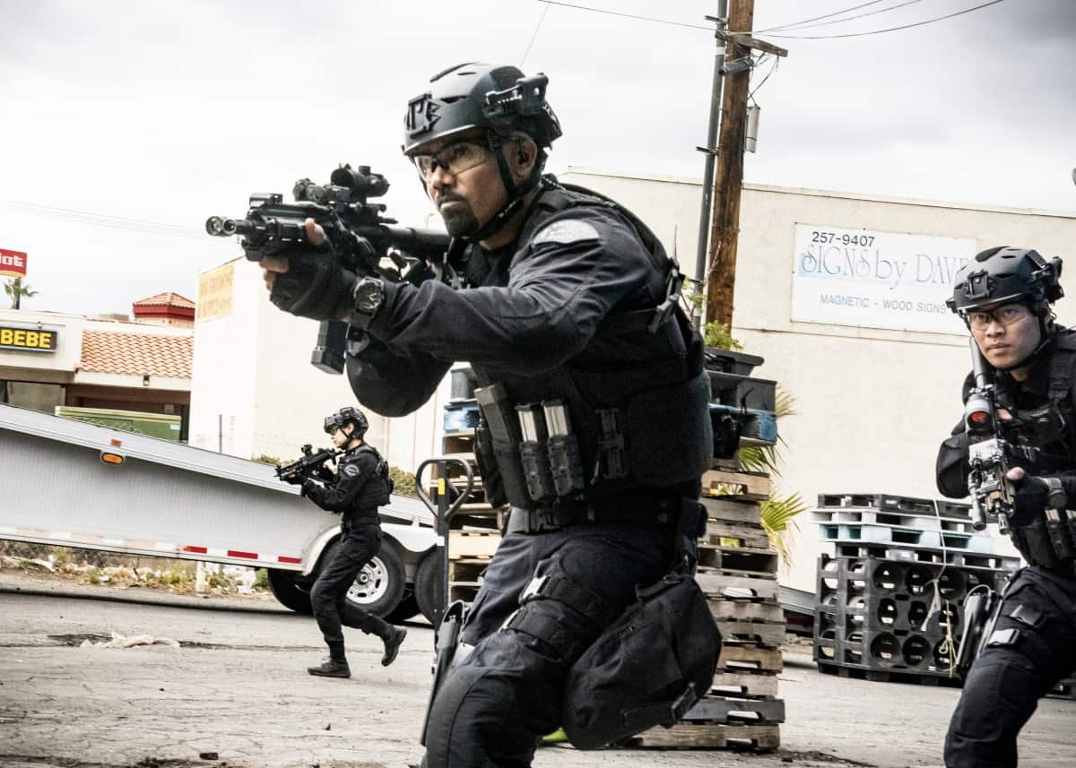 """SWAT Season 4 Episode 17 """"Whistleblower"""" – The team races to rescue victims of a sex trafficking ring that's preying on disenfranchised women. Also, Hondo finds himself at odds with Leroy and Darryl over the future of their business, and Street confronts Chris about meeting with his hospitalized mom, on S.W.A.T., Wednesday, May 19 (10:00-11:00 PM, ET/PT) on the CBS Television Network. Pictured (L-R): Shemar Moore as Daniel """"Hondo"""" Harrelson and David Lim as Victor Tan. Photo: Bill Inoshita/CBS ©2021 CBS Broadcasting, Inc. All Rights Reserved."""