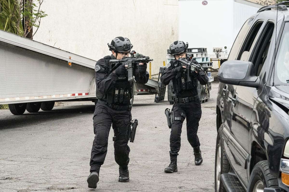 """SWAT Season 4 Episode 17 """"Whistleblower"""" – The team races to rescue victims of a sex trafficking ring that's preying on disenfranchised women. Also, Hondo finds himself at odds with Leroy and Darryl over the future of their business, and Street confronts Chris about meeting with his hospitalized mom, on S.W.A.T., Wednesday, May 19 (10:00-11:00 PM, ET/PT) on the CBS Television Network. Pictured (L-R): Alex Russell as Jim Street and Lina Esco as Christina """"Chris"""" Alonso. Photo: Bill Inoshita/CBS ©2021 CBS Broadcasting, Inc. All Rights Reserved."""