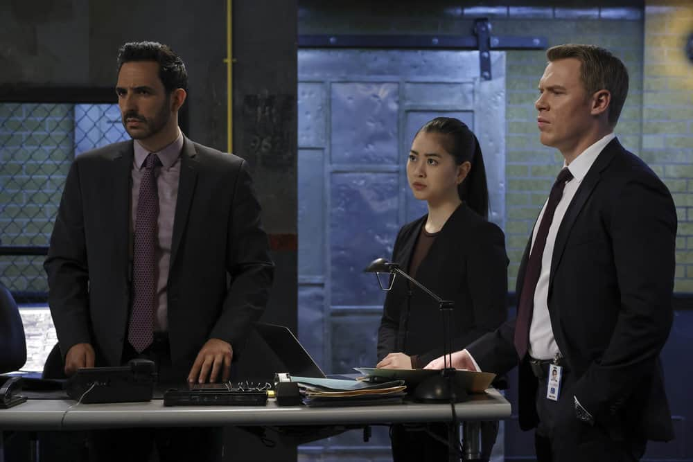 "THE BLACKLIST Season 8 Episode 18 -- ""The Protean (#36)"" Episode 818 -- Pictured: (l-r) Amir Arison as Aram Mojtabai, Laura Sohn as Agent Alina Park, Diego Klattenhoff as Donald Ressler -- (Photo by: Will Hart/NBC)"