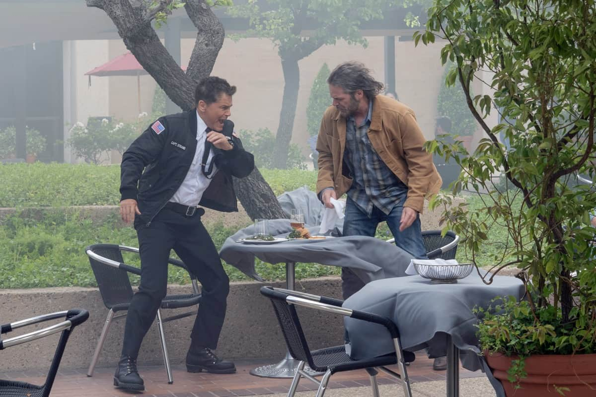 """9-1-1 LONE STAR Season 2 Episode 14: L-R: Rob Lowe and guest star Billy Burke in the """"Dust to Dust"""" season finale episode of 9-1-1: LONE STAR airing Monday, May 24 (9:01-10:00 PM ET/PT) on FOX. © 2021 Fox Media LLC. CR: Jack Zeman/FOX."""