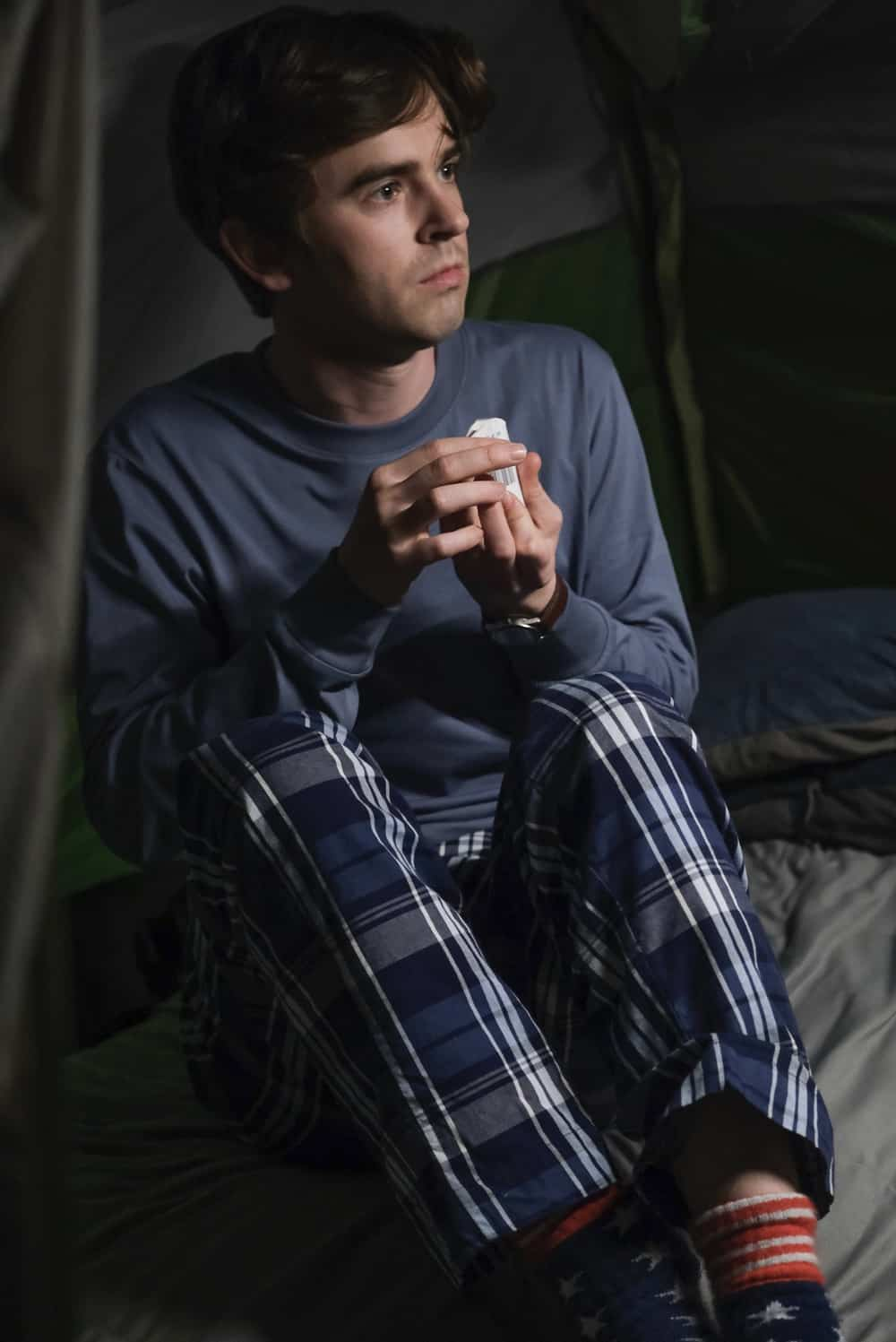"""THE GOOD DOCTOR Season 4 Episode 18 - """"Forgive or Forget"""" – Shaun and Lea go on a camping trip to distract themselves from their grief over their miscarriage. Meanwhile, Morgan and Park argue about the best course of treatment for their patient on an all-new episode of """"The Good Doctor,"""" MONDAY, MAY 24 (10:00-11:00 p.m. EDT), on ABC. (ABC/Jeff Weddell) FREDDIE HIGHMORE"""