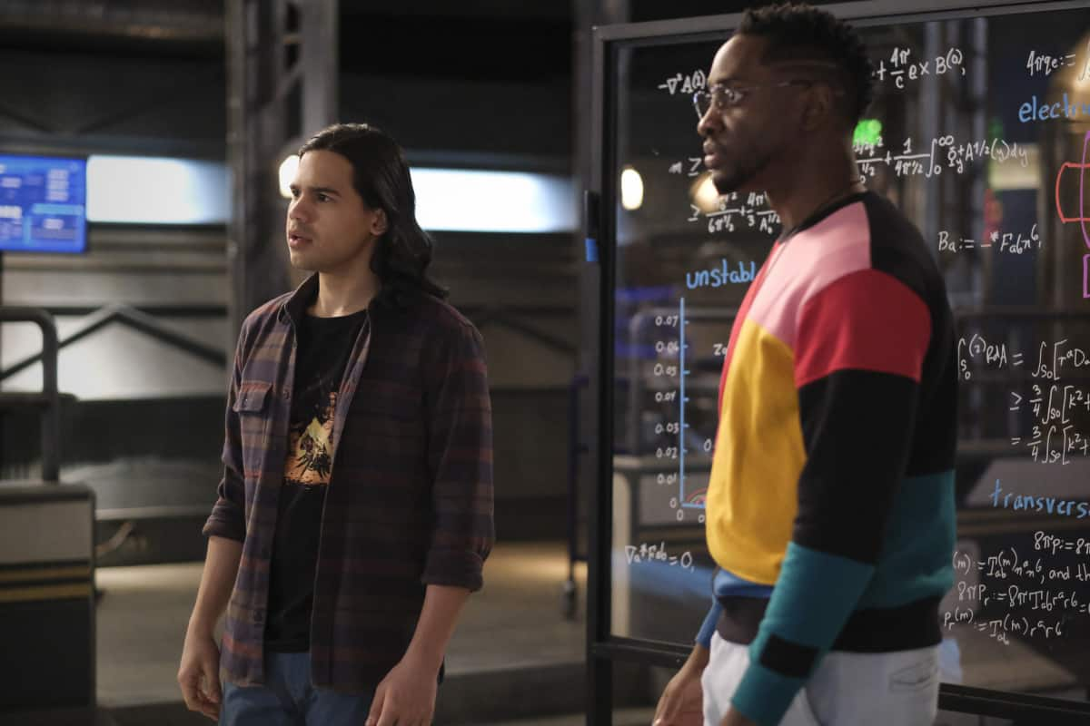 """THE FLASH Season 7 Episode 11-- """"Family Matters, Part 2"""" -- Image Number: FLA711a_0130r.jpg -- Pictured (L-R): Carlos Valdes as Cisco Ramon and Brandon McKnight as Chester P. Runk -- Photo: Bettina Strauss/The CW -- © 2021 The CW Network, LLC. All Rights Reserved.Photo Credit: Bettina Strauss"""