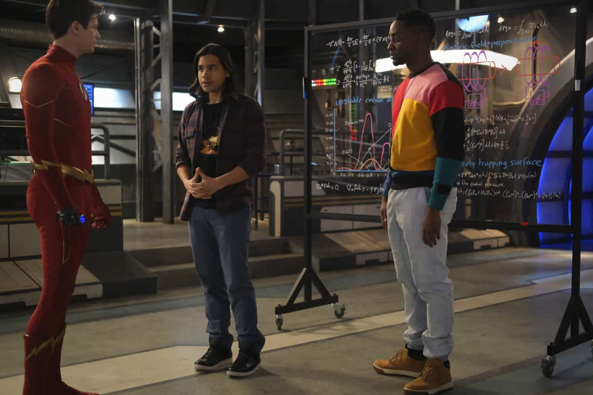 """THE FLASH Season 7 Episode 11 -- """"Family Matters, Part 2"""" -- Image Number: FLA711a_0100r.jpg -- Pictured (L-R): Grant Gusitn as Barry Allen/The Flash, Carlos Valdes as Cisco Ramon and Brandon McKnight as Chester P. Runk -- Photo: Bettina Strauss/The CW -- © 2021 The CW Network, LLC. All Rights Reserved.Photo Credit: Bettina Strauss"""