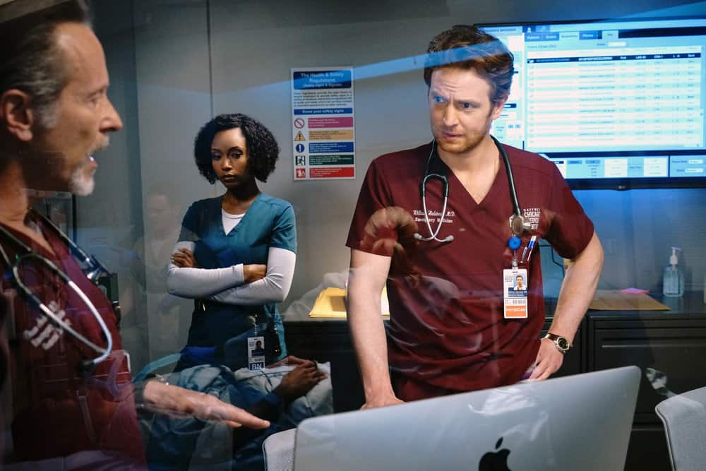 """CHICAGO MED Season 6 Episode 16 -- """"I Will Come To Save You"""" Episode 616 -- Pictured: (l-r) Steven Weber as Dr. Dean Archer, Yaya DaCosta as April Sexton, Nick Gehlfuss as Dr. Will Halstead -- (Photo by: Elizabeth Sisson/NBC)"""
