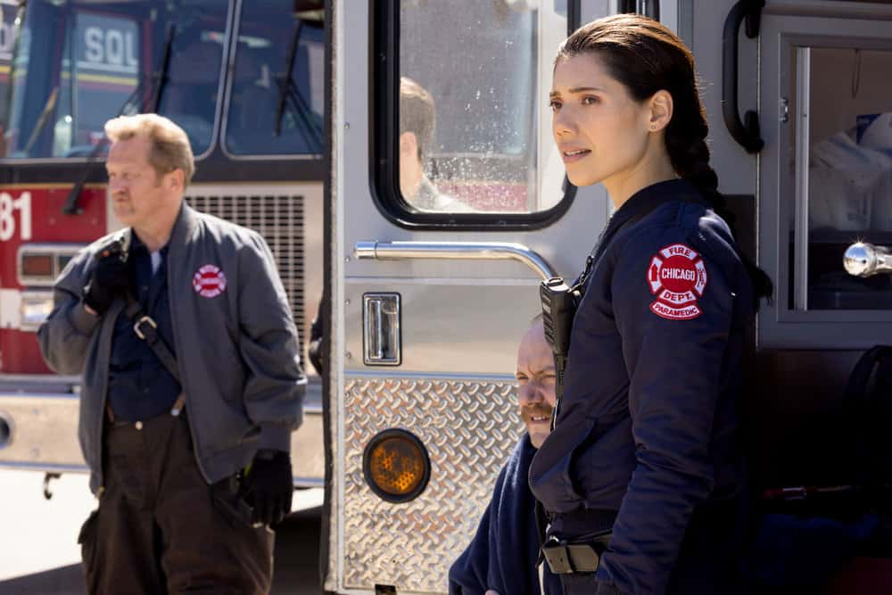 """CHICAGO FIRE Season 9 Episode 16-- """"No Survivors"""" Episode 916 -- Pictured: (l-r) Christian Stolte as Randall """"Mouch"""" McHolland, Hanako Greensmith as Violet -- (Photo by: Adrian S. Burrows Sr./NBC)"""