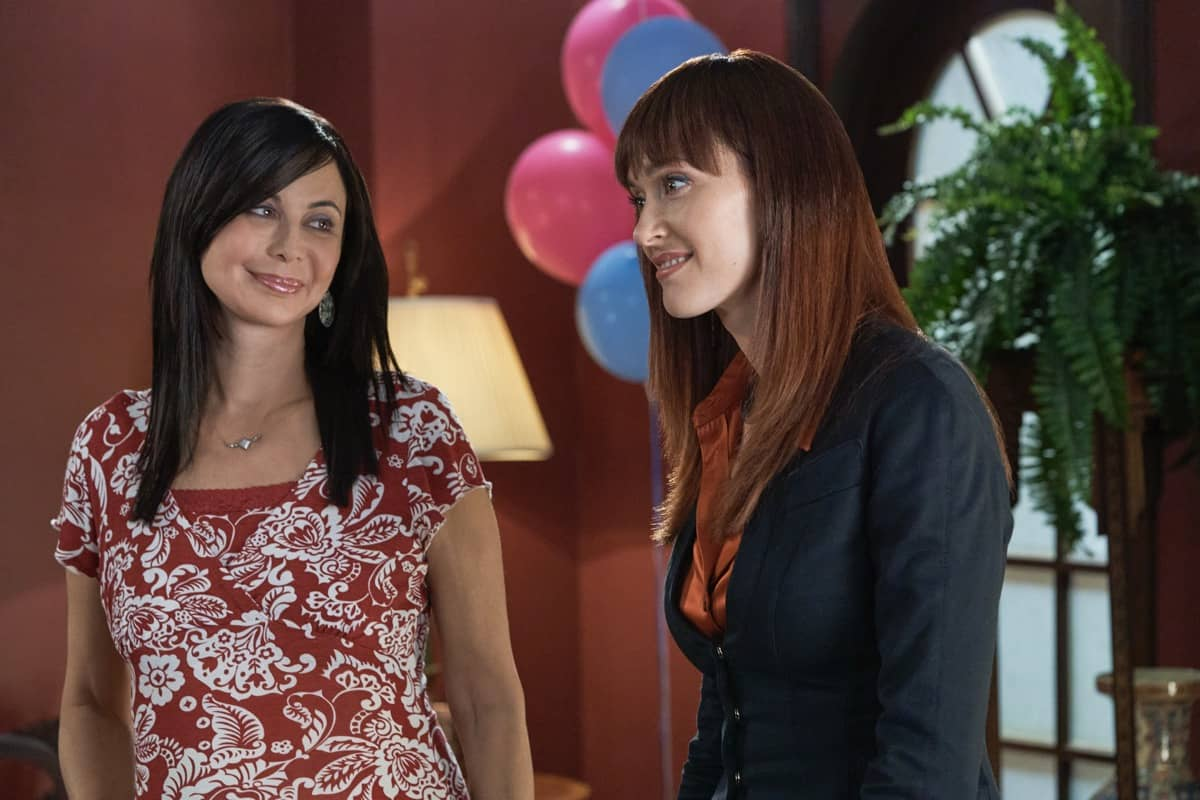 GOOD WITCH Season 7 Episode 3 - When Cassie, Abigail and Stephanie help Martha throw her daughter-in-law, Claire, a baby shower the trio reminisces about Cassie's years ago.  Photo: Catherine Bell, Sarah Power  Credit: ©2021 Crown Media United States LLC/Photographer: Peter Stranks