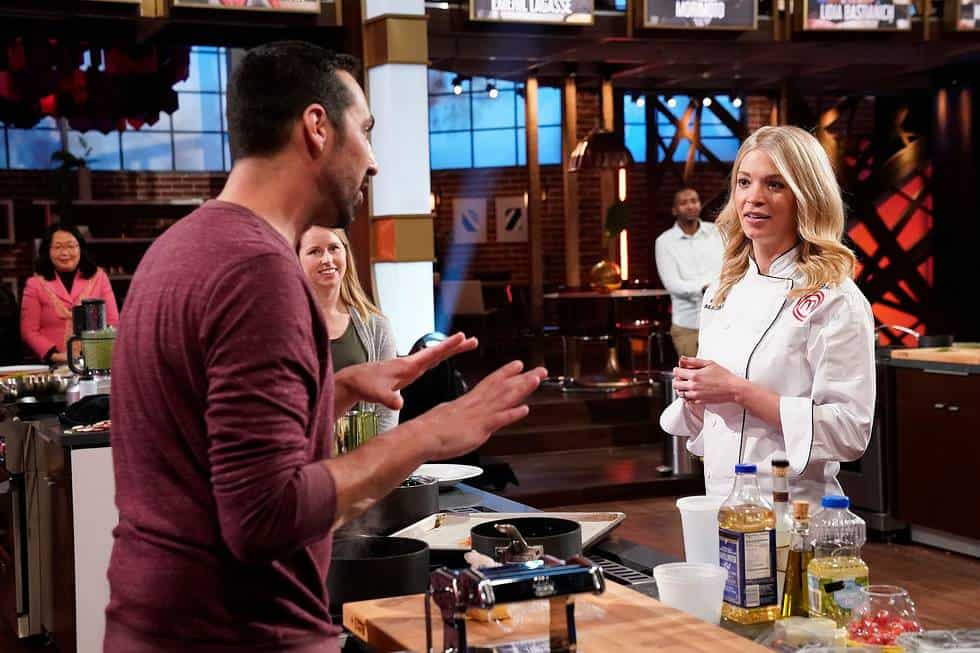 """MASTERCHEF Season 11 Episode 1 : L-R: A Contestant with previous contestant Sarah in the """"Legends: Emeril Lagasse - Auditions Round 1"""" season premiere episode of MASTERCHEF airing Wednesday, June 2 (8:00-9:00 PM ET/PT) on FOX. © 2019 FOX MEDIA LLC. CR: FOX."""