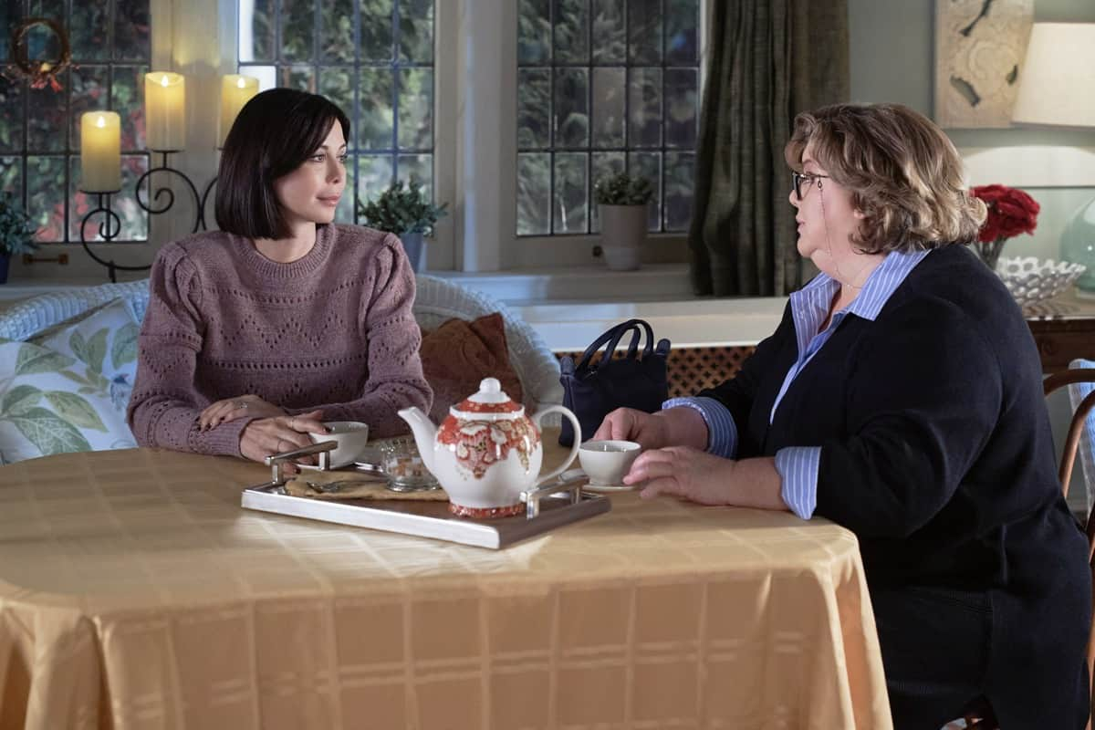 GOOD WITCH Season 7 Episode 4 The Middleton Exchange tradition is revived when Joy makes a discovery in Martha's office. Sam's upcoming surgery on a superstar basketball player doesn't go as planned.  Photo: Catherine Bell, Catherine Disher  Credit: ©2021 Crown Media United States LLC/Photographer: Peter Stranks