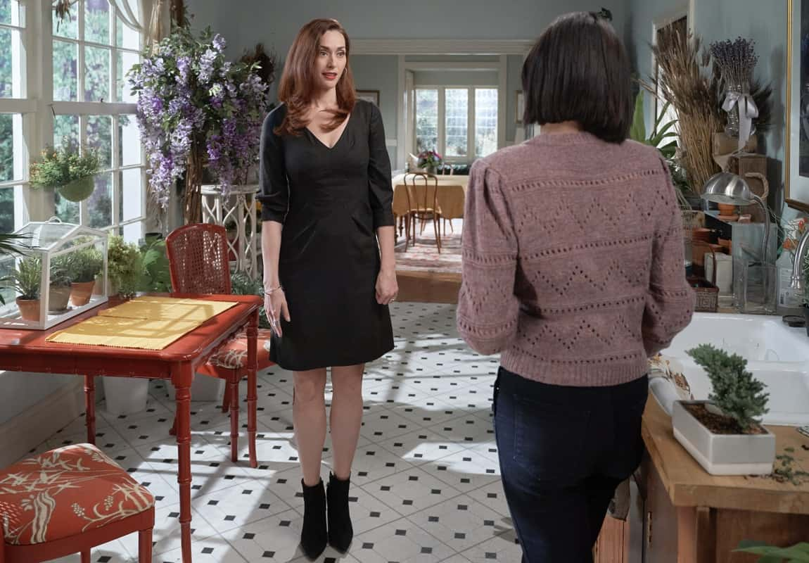 GOOD WITCH Season 7 Episode 4 The Middleton Exchange tradition is revived when Joy makes a discovery in Martha's office. Sam's upcoming surgery on a superstar basketball player doesn't go as planned.  Photo: Sarah Power, Catherine Bell  Credit: ©2021 Crown Media United States LLC/Photographer: Peter Stranks