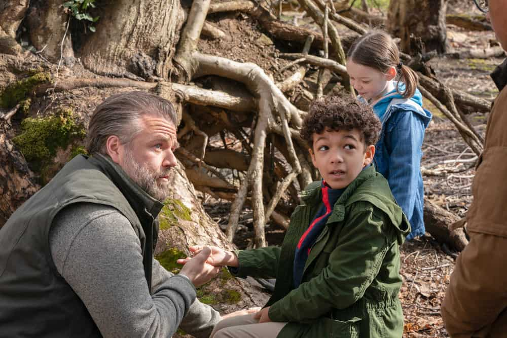 """NEW AMSTERDAM Season 3 Episode 14 -- """"Death Begins in Radiology"""" Episode 314 -- Pictured: (l-r) Tyler Labine as Dr. Iggy Frome, Colton Osorio as Raffi -- (Photo by: Virginia Sherwood/NBC)"""