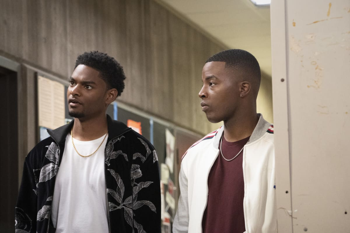 """ALL AMERICAN Season 3 Episode 17 -- """"All American: Homecoming"""" -- Image Number: ALA316b_0380r.jpg -- Pictured (L-R): Sylvester Powell as JR and Daniel Ezra as Spencer -- Photo: Bill Inoshita/The CW -- © 2021 The CW Network, LLC. All Rights Reserved"""