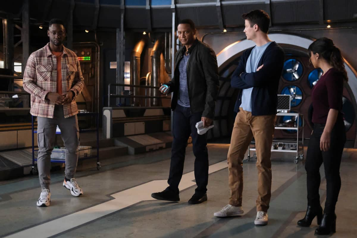 """THE FLASH Season 7 Episode 16 -- """"P.O.W."""" -- Image Number: FLA716b_0020r.jpg – Pictured (L-R): Brandon McKnight as Chester P. Runk, David Ramsey as John Diggle, Grant Gustin as Barry Allen and Danielle Nicolet as Cecile Horton -- Photo: Bettina Strauss/The CW -- © 2021 The CW Network, LLC. All Rights Reserved. Photo Credit: Bettina Strauss"""