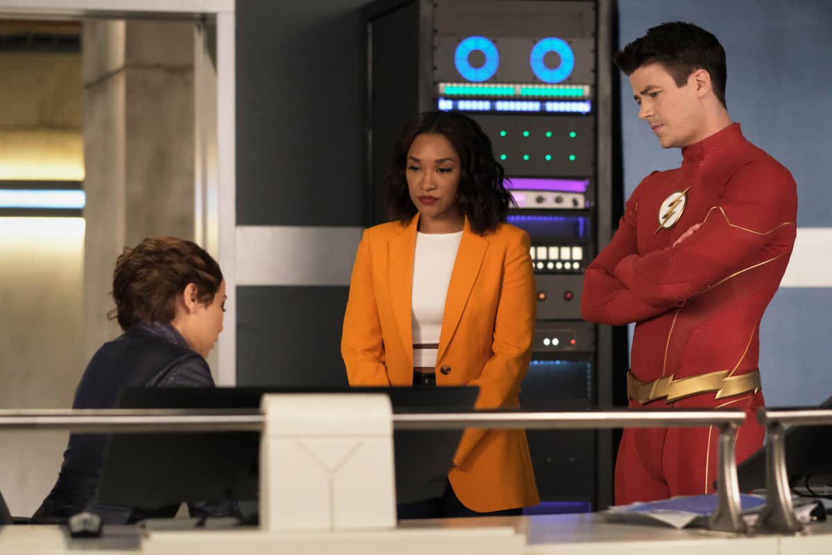 """THE FLASH Season 7 Episode 17 -- """"Heart of the Matter, Part 1"""" -- Image Number: FLA717a_0085r.jpg -- Pictured (L-R): Jessica Parker Kennedy as Nora/XS, Candice Patton as Iris  West - Allen and Grant Gustin as Barry Allen  -- Photo: Bettina Strauss/The CW -- © 2021 The CW Network, LLC. All Rights Reserved"""