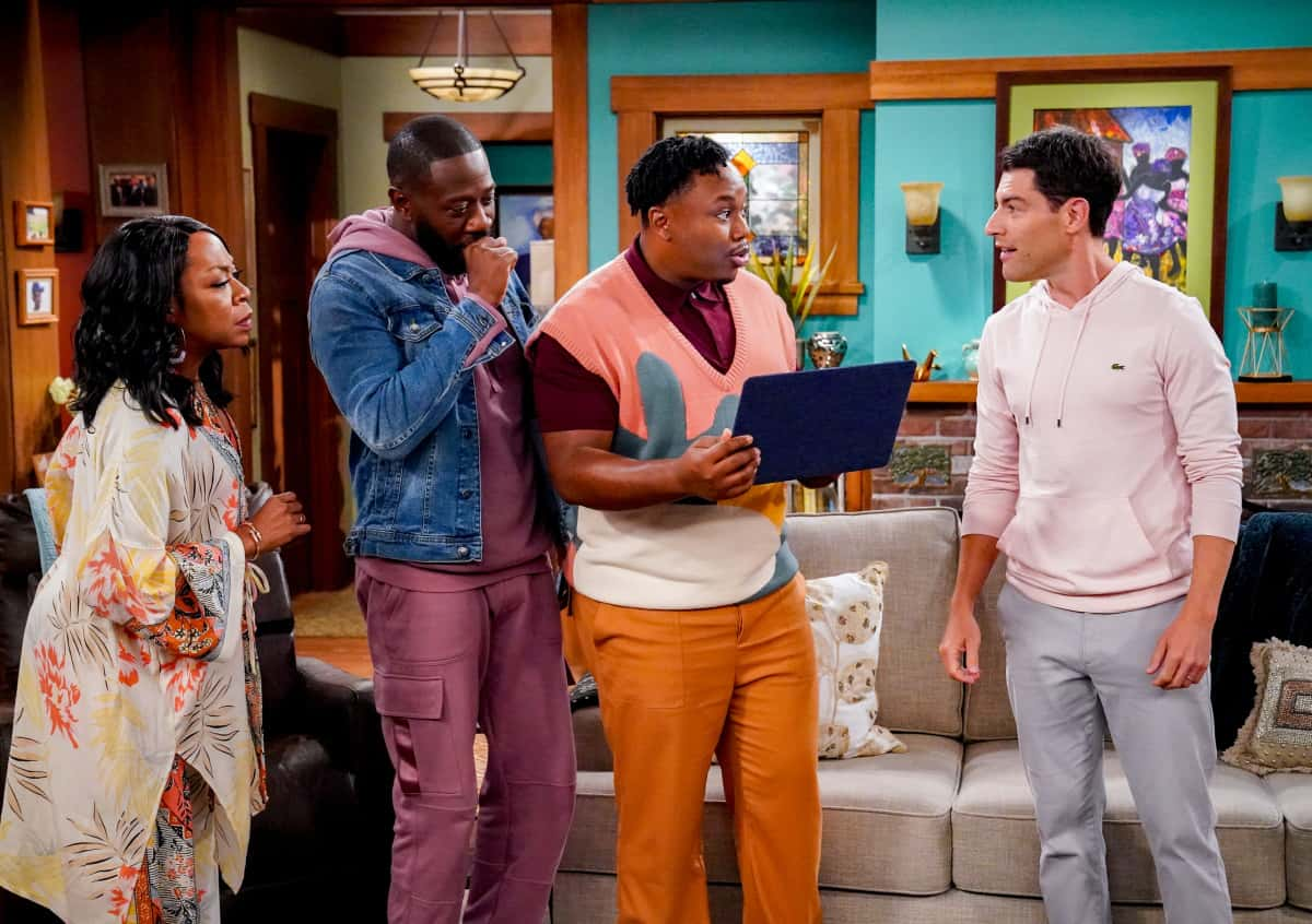 """THE NEIGHBORHOOD Season 4 Episode 1 """"Welcome to the Family"""" - Pictured: Tichina Arnold (Tina Butler), Sheaun McKinney (Malcolm Butler), Marcel Spears (Marty Butler) and Max Greenfield (Dave Johnson). When Dave starts researching his genealogy, he makes a surprising discovery: He and Calvin are more than just neighbors. Also, Tina offers to help Gemma when she's overcome with morning sickness, and inadvertently stumbles on a new business idea, on the fourth season premiere of THE NEIGHBORHOOD, Monday, Sept. 20 (8:00-8:30 PM, ET/PT) on the CBS Television Network and available to stream live and on demand on the CBS app and Paramount+. Photo: Monty Brinton/CBS ©2021 CBS Broadcasting, Inc. All Rights Reserved."""