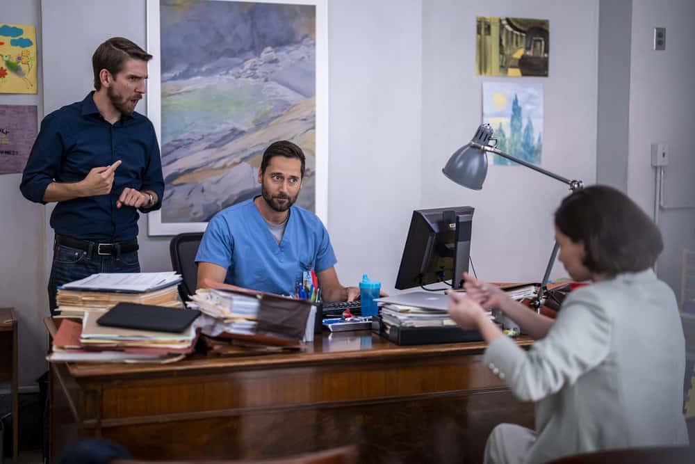 "NEW AMSTERDAM Season 4 Episode 1 -- ""More Joy"" Episode 401 -- Pictured: (l-r) Conner Marx as Ben, Ryan Eggold as Dr. Max Goodwin -- (Photo by: Zach Dilgard/NBC)"