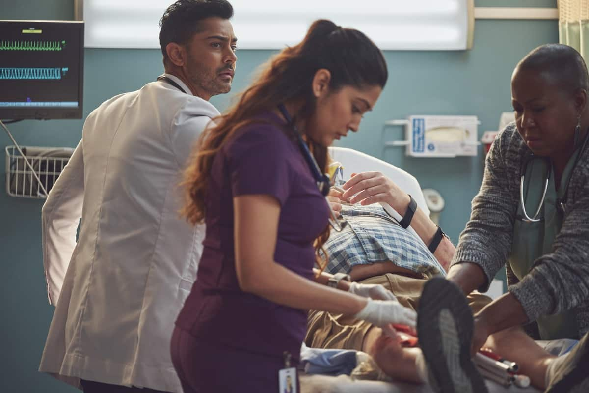 """THE RESIDENT Season 5 Episode 1:  L-R: Manish Dayal, Anuja Joshi and guest star Denitra Isler in the """"DA DA """" season premiere episode of THE RESIDENT airing Tuesday, Sept. 21 (8:00-9:00 PM ET/PT) on FOX. ©2021 Fox Media LLC Cr: Tom Griscom/FOX"""