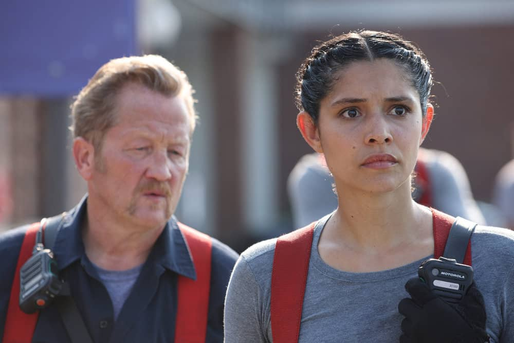 """CHICAGO FIRE Season 10 Episode 1 -- """"Mayday"""" Episode 1001 -- Pictured: (l-r) Christian Stolte as Randall """"Mouch"""" McHolland, Miranda Rae Mayo as Stella Kidd -- (Photo by: Adrian S. Burrows Sr./NBC)"""