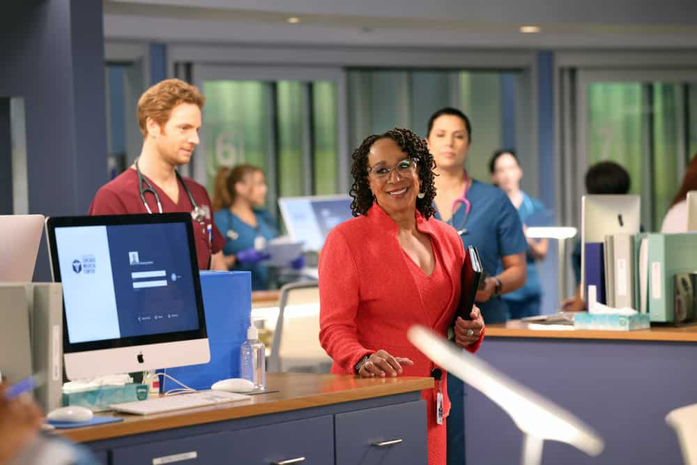 """CHICAGO MED Season 7 Episode 1 -- """"You Can't Always Trust What You See"""" Episode 701 -- Pictured: (l-r) Nick Gehlfuss as Dr. Will Halstead, S. Epatha Merkerson as Sharon Goodwin -- (Photo by: George Burns Jr/NBC)"""