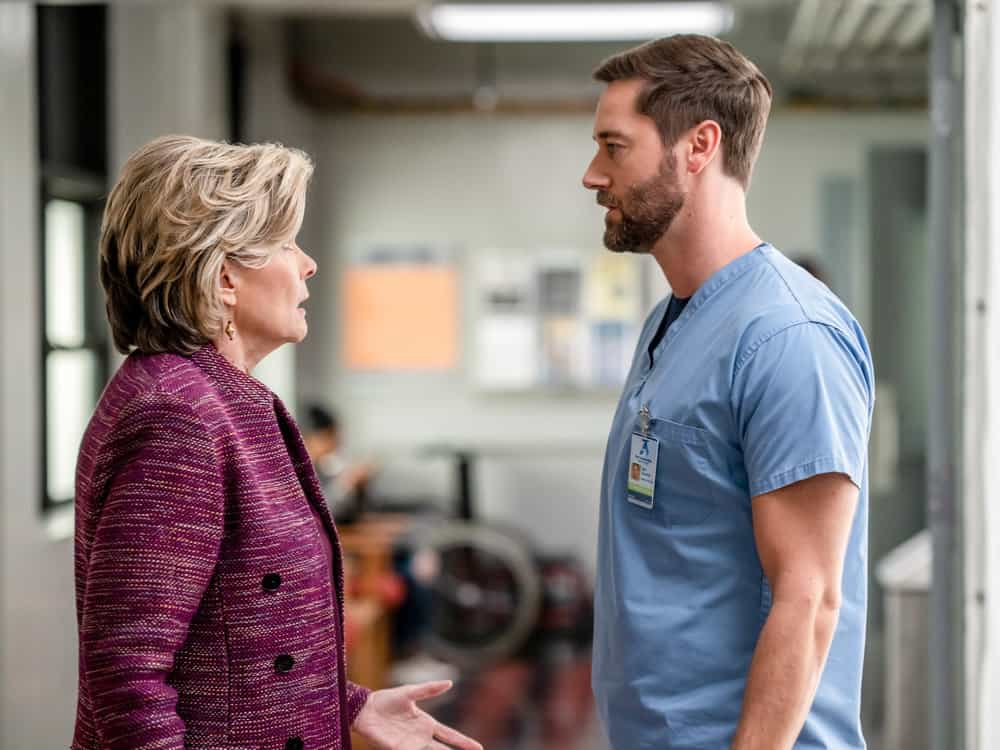 """NEW AMSTERDAM Season 4 Episode 2 -- """"We're In This Together"""" Episode 402 -- Pictured: (l-r) Debra Monk as Karen Brantley, Ryan Eggold as Dr. Max Goodwin -- (Photo by: Zach Dilgard/NBC)"""