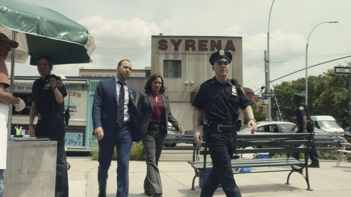 """BLUE BLOODS Season 12 Episode 1 """"Hate is Hate"""" -- As Danny consults a psychic to solve the murder of a young boy, Frank is at odds with the mayor over how best to protect the city from an uptick in crime following a high-profile shooting. Also, Erin investigates a decades-old case in which the primary eyewitness to the killing is her boss, D.A. Kimberly Crawford (Roslyn Ruff), who was 13 years old at the time, on the 12th season premiere of BLUE BLOODS, Friday, Oct. 1 (10:00-11:00 PM, ET/PT) on the CBS Television Network, and available to stream live and on demand on Paramount+. Callie Thorne returns as psychic medium Maggie Gibson and Dylan Walsh guest stars as Mayor Peter Chase. Pictured: Donnie Wahlberg as Danny Reagan, Marisa Ramirez as Maria Baez,  Photo: Best Possible Screengrab ©2021 CBS Broadcasting Inc. All Rights Reserved."""