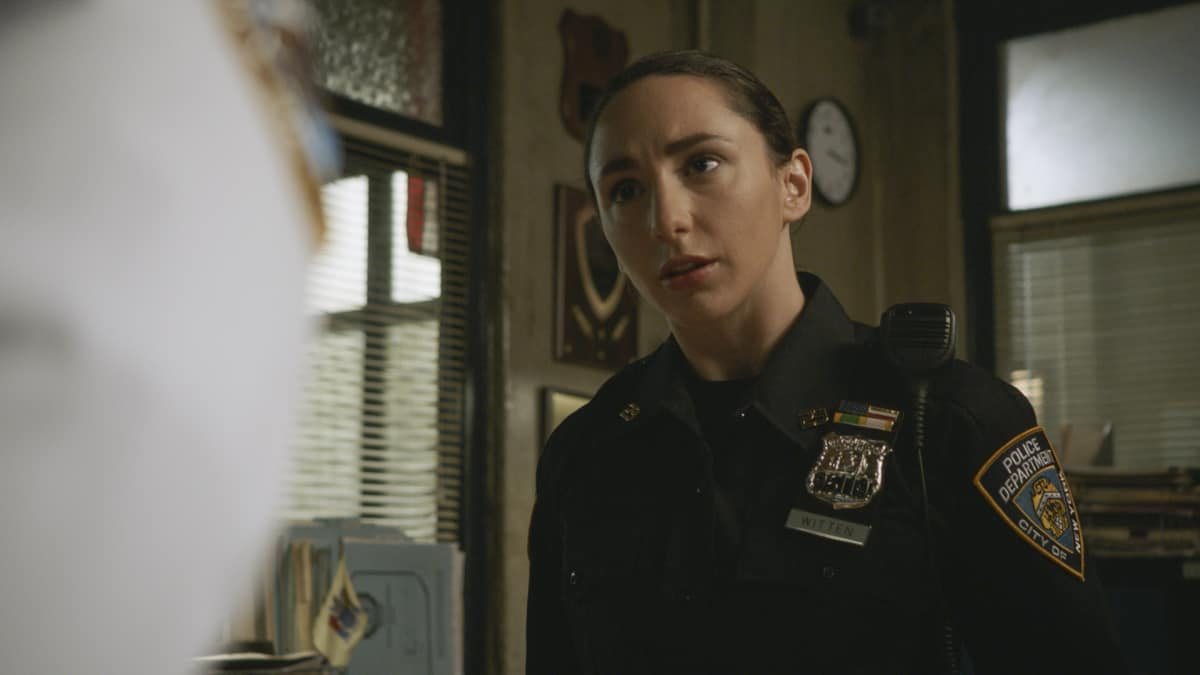 """BLUE BLOODS Season 12 Episode 1 """"Hate is Hate"""" -- As Danny consults a psychic to solve the murder of a young boy, Frank is at odds with the mayor over how best to protect the city from an uptick in crime following a high-profile shooting. Also, Erin investigates a decades-old case in which the primary eyewitness to the killing is her boss, D.A. Kimberly Crawford (Roslyn Ruff), who was 13 years old at the time, on the 12th season premiere of BLUE BLOODS, Friday, Oct. 1 (10:00-11:00 PM, ET/PT) on the CBS Television Network, and available to stream live and on demand on Paramount+. Callie Thorne returns as psychic medium Maggie Gibson and Dylan Walsh guest stars as Mayor Peter Chase. Pictured: Lauren Patten as Officer Rachel Witten Photo: Best Possible Screengrab ©2021 CBS Broadcasting Inc. All Rights Reserved."""