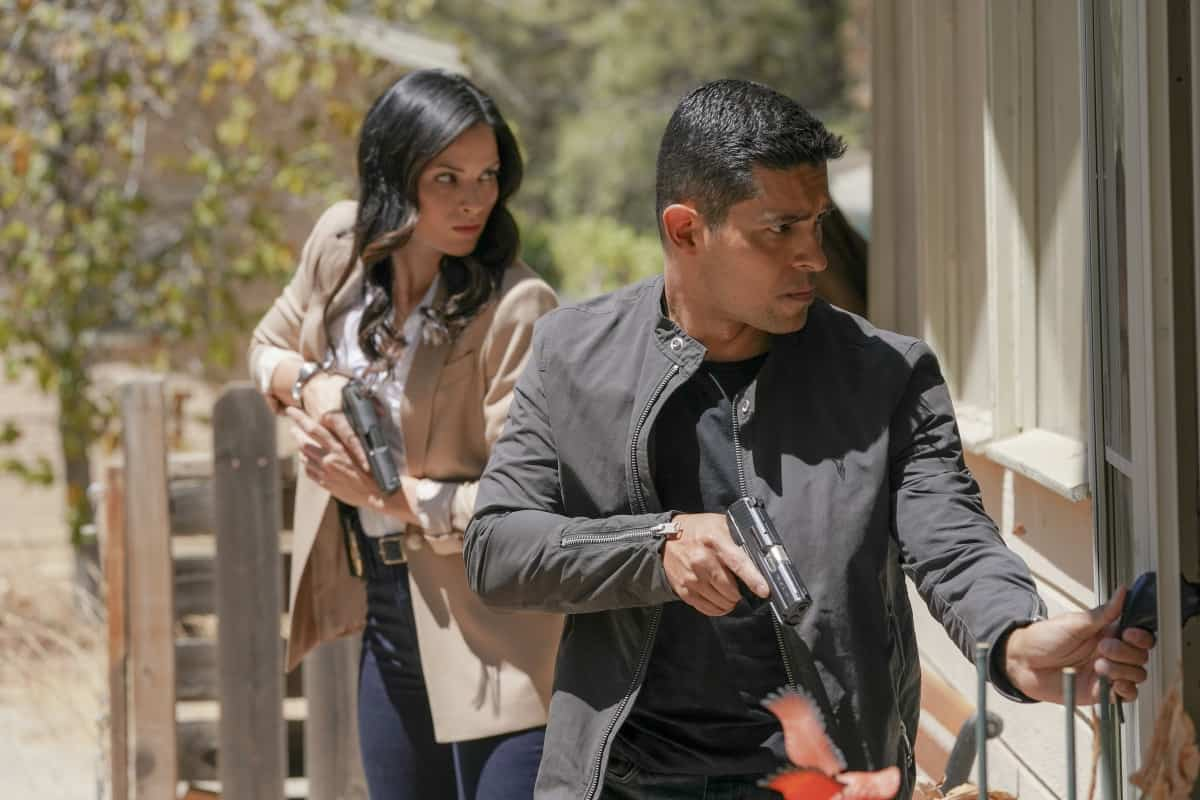 """NCIS Season 19 Episode 3 """"Road to Nowhere"""" – Gibbs and Parker go on a road trip to find one of the serial killer's victims. Also, Agent Knight goes undercover at a large manufacturing company with ties to the murders, on the CBS Original series NCIS, Monday, Oct. 4 (9:00-10:00 PM, ET/PT) on the CBS Television Network, and available to stream live and on demand on Paramount+. Rocky Carroll directed the episode. Pictured: Katrina Law as NCIS Special Agent Jessica Knight, Wilmer Valderrama as NCIS Special Agent Nicholas """"Nick"""" Torres.  Photo: Michael Yarish/CBS ©2021 CBS Broadcasting, Inc. All Rights Reserved."""