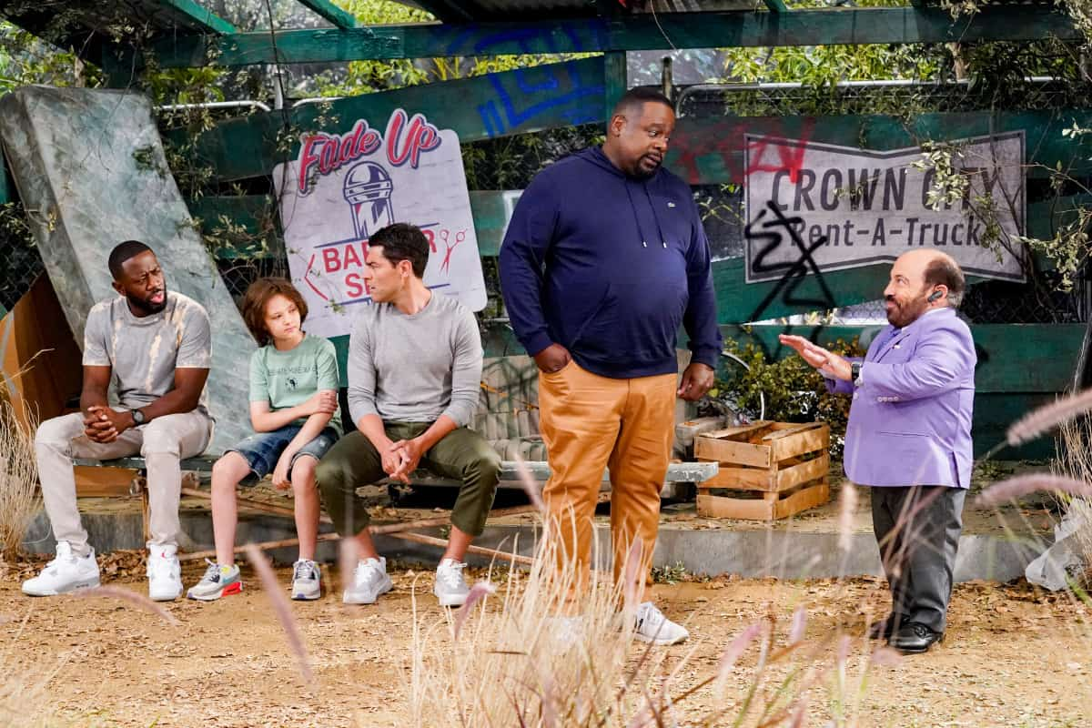 """THE NEIGHBORHOOD Season 4 Episode 3 """"Welcome to the Sister from Another Mister"""" – Pictured: Sheaun McKinney (Malcolm Butler), Hank Greenspan (Grover Johnson), Max Greenfield (Dave Johnson), Cedric the Entertainer (Calvin Butler) and Danny Woodburn (Mayor Clyborne). When Gemma hires Alexis (guest star Nicole Sullivan) to teach at her school, Tina suspects the new teacher may not be quite who she claims to be. Also, Calvin tries to save the community baseball field where he first taught Malcolm how to play, on CBS Original series THE NEIGHBORHOOD, Monday, Oct. 4 (8:00-8:30 PM, ET/PT) on the CBS Television Network. Photo: Monty Brinton/CBS ©2021 CBS Broadcasting, Inc. All Rights Reserved."""