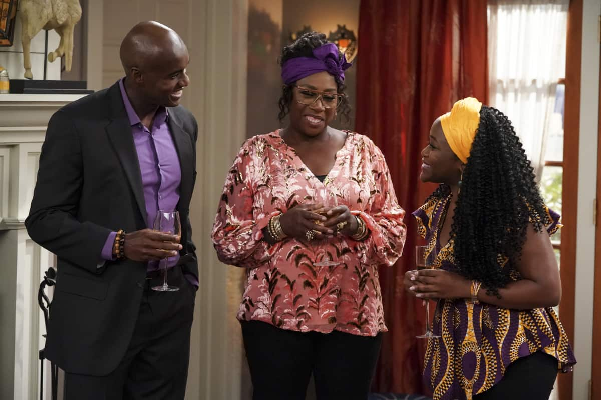 """BOB HEARTS ABISHOLA Season 3 Episode 3 """"Dud"""" – After returning home from their wedding in Nigeria, Abishola moves into Bob's house, and with his blessing, she redecorates to make the place her own. At their housewarming party, their friends and family make their opinions on Abishola's taste known, on the CBS Original series BOB HEARTS ABISHOLA, Monday, Oct. 4 (8:30-9:00 PM, ET/PT) on the CBS Television Network, and available to stream live and on demand on Paramount+.   Pictured (L-R): Tony Tambi as Chukwuemeka, Gina Yashere as Kemi, and Tori Danner as Morenike. Photo credit: Michael Yarish/2021 Warner Bros. Entertainment Inc. All Rights Reserved."""
