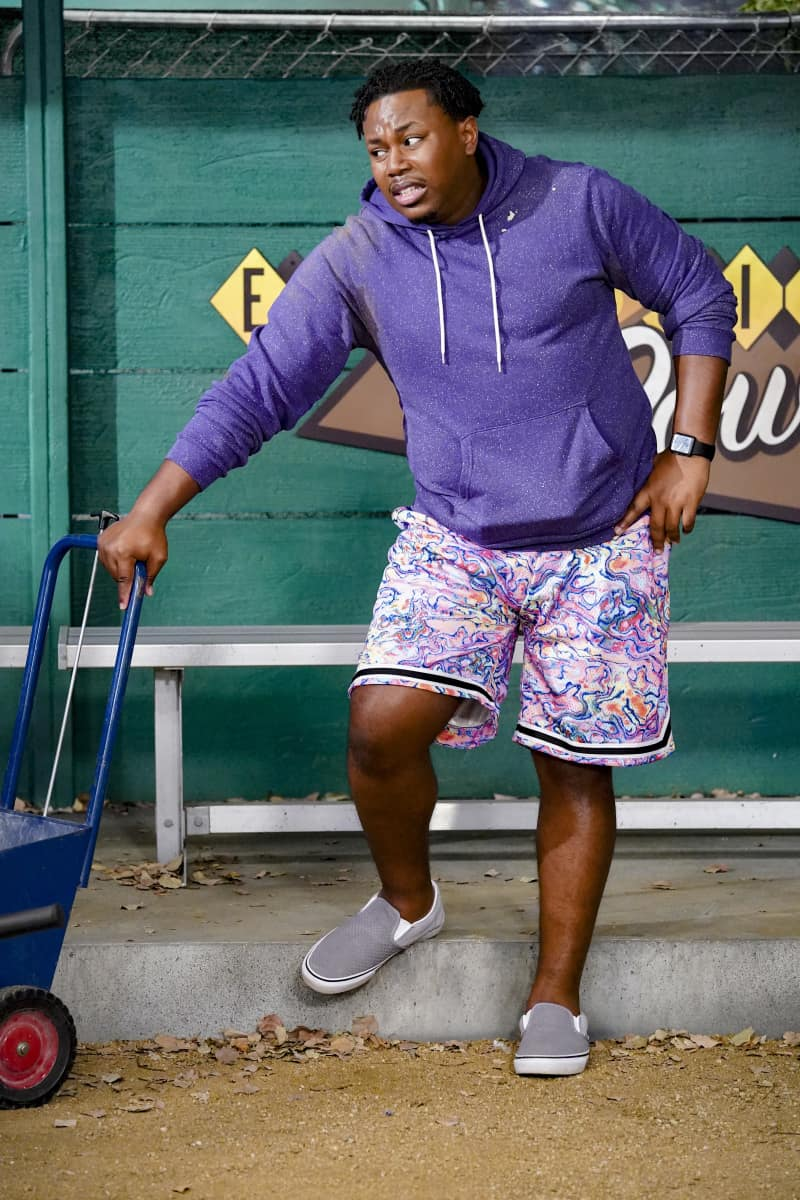 """THE NEIGHBORHOOD Season 4 Episode 3 """"Welcome to the Sister from Another Mister"""" – Pictured: Marcel Spears (Marty Butler). When Gemma hires Alexis (guest star Nicole Sullivan) to teach at her school, Tina suspects the new teacher may not be quite who she claims to be. Also, Calvin tries to save the community baseball field where he first taught Malcolm how to play, on CBS Original series THE NEIGHBORHOOD, Monday, Oct. 4 (8:00-8:30 PM, ET/PT) on the CBS Television Network. Photo: Monty Brinton/CBS ©2021 CBS Broadcasting, Inc. All Rights Reserved."""